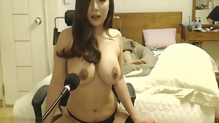 Korean beauty adjacent to stockings plays with her huge tits