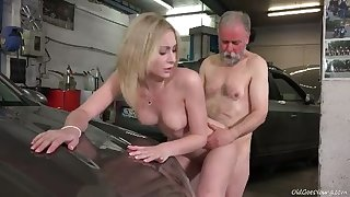 Awesome sexy blonde chick rides older man's lion-hearted cock in the garage